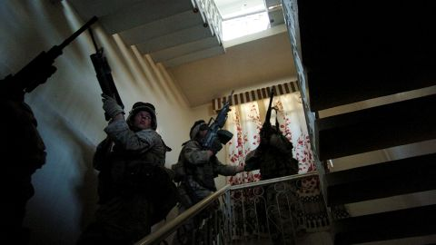 Marines search houses in Fallujah for insurgents on November 10, 2004.