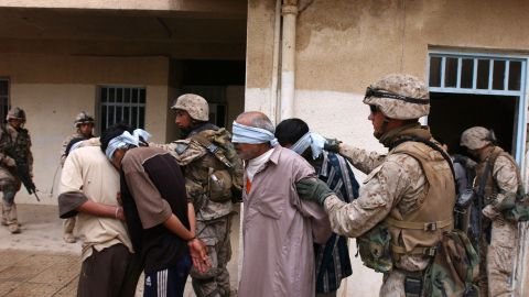 Iraqi men are arrested during a house raid in Fallujah on November 13, 2004.