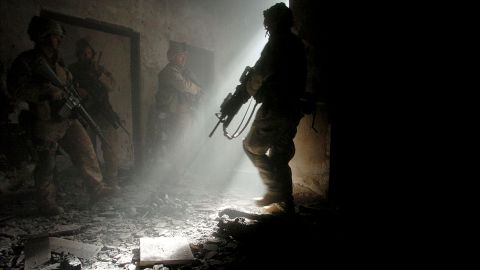 Marines clear a home in Fallujah after four insurgents staged a bloody counterattack, killing one American and wounding many others, on November 23, 2004.