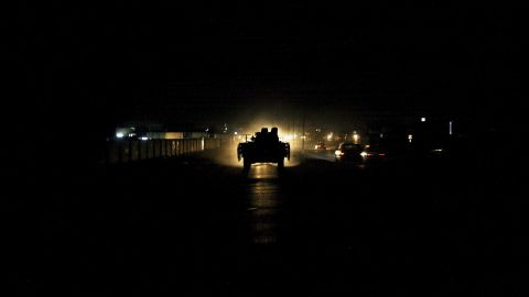 A British armored vehicle is illuminated by traffic during a patrol of Basra on July 27, 2006.