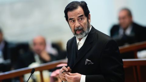 Ousted Iraqi leader Saddam Hussein addresses the court during his trial in the heavily fortified Green Zone of Baghdad on October 17, 2006. Hussein and six co-defendants were on trial for mass killings in the Anfal campaign against Kurdish rebels in the late 1980s.