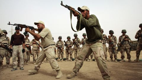 Iraqi army commandos teach junior soldiers during a combat training course in Baquba on July 18, 2007.