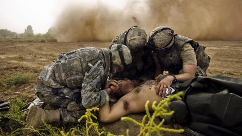 Medics treat Army Spc. Jose Callazo after his mine-detecting vehicle hit a buried IED in Hawr Rajab on August 4, 2007.