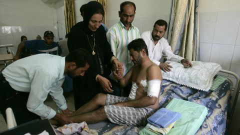 Relatives help an Iraqi man at a hospital in Baghdad on September 20, 2007. He was injured when Blackwater security contractors opened fire on civilians on September 16, killing 17. The company lost its contract to guard U.S. staff in Iraq after the country's government refused to renew its operating license.
