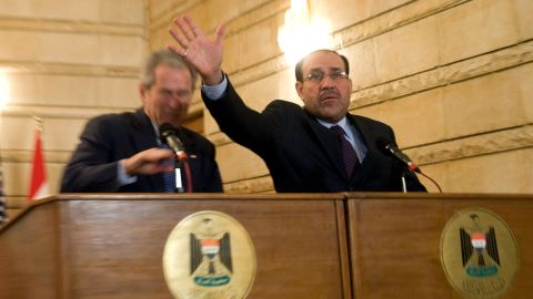 """Iraqi Prime Minister Nuri al-Maliki tries to block a shoe thrown at President Bush during a news conference in Baghdad on December 14, 2008. The Iraqi journalist who threw the shoes missed the president but could be heard yelling in Arabic, """"This is a farewell ... you dog!"""""""