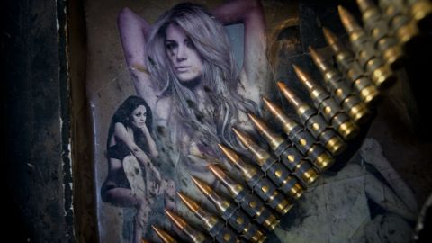 A string of bullets lies across photographs of women adorning the armor of a Stryker vehicle north of Jalaulah on June 11, 2010.