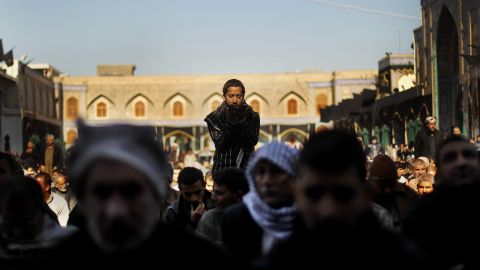Shiite worshipers pray during an Ashura commemoration ceremony at the Kadhimiya shrine in Baghdad on December 6, 2011. Ashura marks the death of Prophet Mohammed's grandson, the revered Imam Hussein.