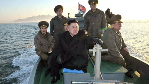 EDITORS NOTE--- RESTRICTED TO EDITORIAL USE - MANDATORY CREDIT 'AFP PHOTO / KCNA VIA KNS' - NO MARKETING NO ADVERTISING CAMPAIGNS - DISTRIBUTED AS A SERVICE TO CLIENTS This undated picture taken by North Korea's official Korean Central News Agency on March 11, 2013 shows North Korean leader Kim Jong Un (C) visiting the Wolnae Islet Defence Detachment in North Korea's western sector near the disputed maritime frontier with South Korea . AFP PHOTO / KCNA via KNS (Photo credit should read KNS/AFP/Getty Images)