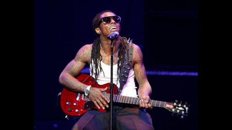 """Rapper Lil Wayne performs onstage during his """"I Am Music"""" Tour at the Gibson Amphitheater on March 29, 2009, in Universal City, California."""