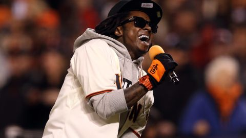 """Lil Wayne sings """"Take Me Out to the Ball Game"""" during the seventh-inning stretch as the San Francisco Giants took on the St. Louis Cardinals during the National League Championship Series in 2012."""