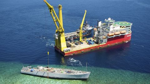 The U.S. Navy and Philippines authorities are working to dismantle the ship.