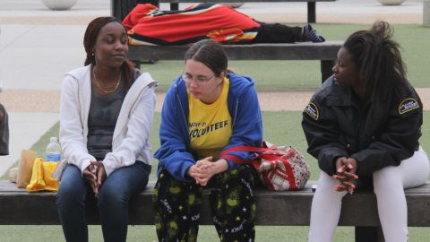 Evacuated students at the University of Central Florida on Monday wait to return to their dorm rooms.