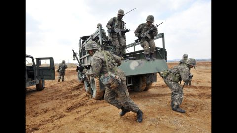 South Korean army soldiers jump off a military truck during a drill outside a U.S. airbase in Pyeongtaek as part of annual joint exercises with the United States on March 14.