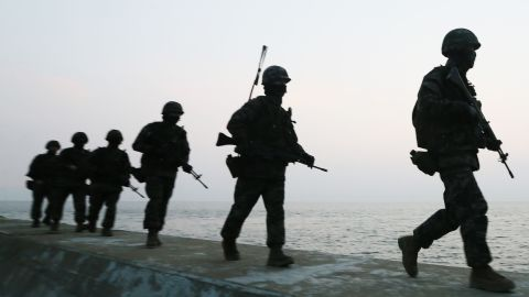 South Korean marines patrol on the South Korea-controlled island of Yeonpyeong near the disputed waters of the Yellow Sea on Tuesday, March 12.