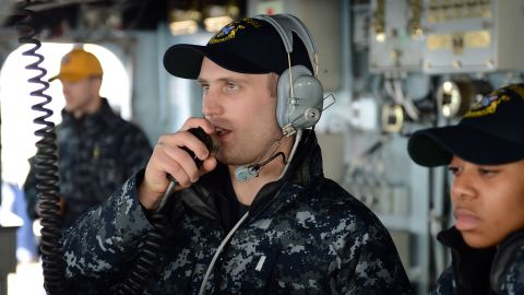 In this Navy handout image taken on March 5, Lt. j.g. Matthew Harmon serves as helm safety officer aboard the guided-missile destroyer USS McCampbell during a replenishment at sea, part of Foal Eagle 2013, the joint exercises between the United States and South Korea.