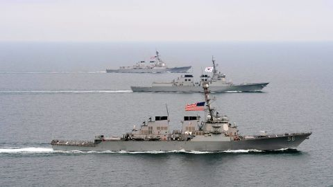 This March 17 Navy handout image shows the destroyer USS John S. McCain, front; the Republic of Korea Navy destroyer ROKS Seoae-Yu-Seong-Ryong, center; and the destroyer USS McCampbell moving into formation in the waters off the Korean Peninsula during exercise Foal Eagle 2013.