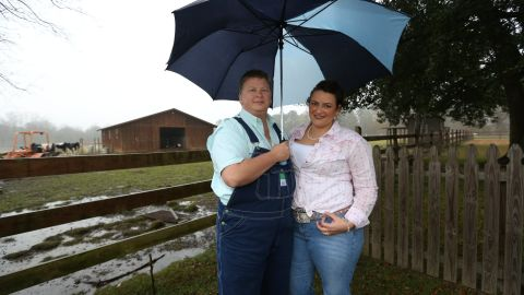 L.B., left, and Sara Bell want to raise a child in Mississippi but worry about their rights as same-sex parents.