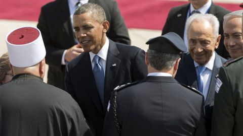Obama greets Israeli officials during the welcome ceremony at the airport on March 20.  Israeli President Shimon Peres, second from right, and Prime Minister Benjamin Netanyahu, right, are by Obama's side.