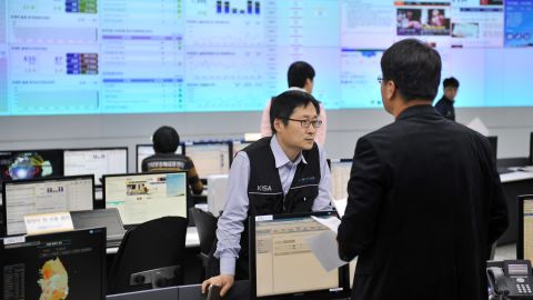 Members of the Korea Internet Security Agency check on cyber attacks in Seoul on March 20.