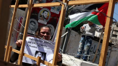 Palestinians in Gaza City hold up placards demonstrating against Obama's visit on March 20.