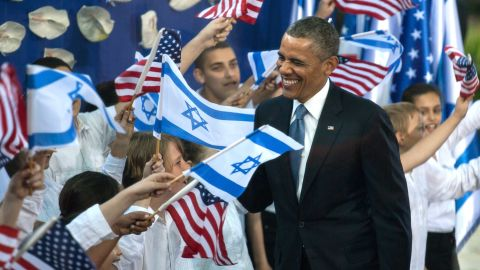 JERUSALEM, ISRAEL - MARCH 20:  U.S. President Barack Obama (L) greets children as he is escorted by Israeli President Shimon Peres following a welcome ceremony at the President's residence on March 20, 2013 in Jerusalem, Israel. This will be Obama's first visit as president to the region, and his itinerary will include meetings with the Palestinian and Israeli leaders as well as a visit to the Church of the Nativity in Bethlehem.  (Photo by Uri Lenz-Pool/Getty Images)