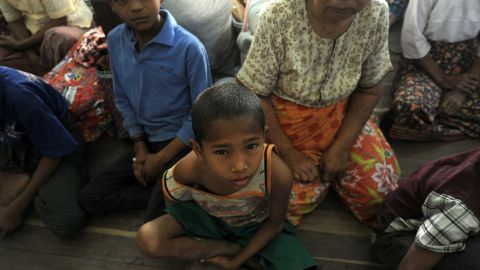 Displaced people rest at a relief camp in Meiktila, central Myanmar on March 24, 2013.