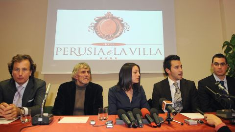 Meredith Kercher's family lawyer Francesco Maresca, left, argued in court in 2011 that the multiple stab wounds implied more than one aggressor killed Kercher. Pictured from left are Maresca, Kercher's father John, sister Stephanie, brother Lyle and brother John at a press conference in 2008.