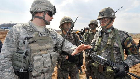 A US Air Force soldier (L) talks to South Korean Army soldiers participate in annual joint exercises south of Seoul, on March 14, 2013.
