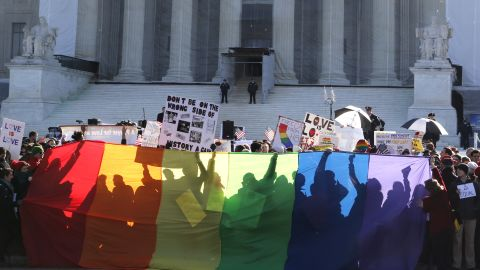 Anti-Proposition 8 protesters are shadowed by a rainbow banner on Tuesday.