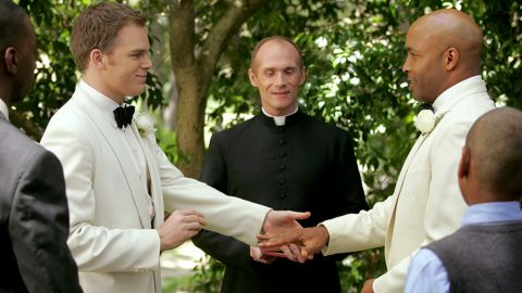 """Critics hailed the realistic portrayal of the relationship between David Fisher (Michael C. Hall, left) and Keith Charles (Mathew St. Patrick) on """"Six Feet Under."""""""