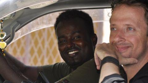 Shiine Akhyaar Ali and Daniel J Gerstle scout locations for a music video in Mogadishu. - (ABDILLAHI ABDILLAHI)