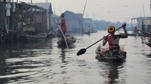 """Nicknamed by some as the """"Venice of Africa,"""" the floating village of Makoko in Lagos, Nigeria, is inhabited by people who not only live on water, but also also depend on it for their livelihood."""
