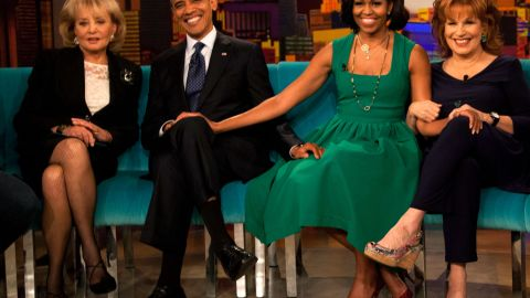 """Walters sits for a photo with President Barack Obama, first lady Michelle Obama and Joy Behar on the set of """"The View"""" in September 2012 in New York."""