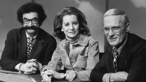 """From left, Gene Shalit, Walters and Frank McGee sit behind the news desk in a promotional portrait for the """"Today Show"""" in 1973."""