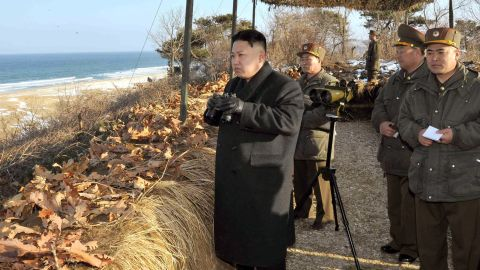 This picture released by North Korea's official Korean Central News Agency on March 26, 2013 and taken on March 25, 2013 shows North Korean leader Kim Jong-Un (C) inspecting the landing and anti-landing drills of KPA Large Combined Units 324 and 287 and KPA Navy Combined Unit 597 at an undisclosed location on North Korea's east coast.