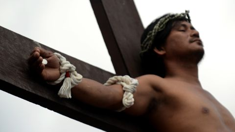 A penitent is nailed to a cross during the reenactment of crucifixion on Good Friday in the village of San Juan, San Fernando City, north of Manila.