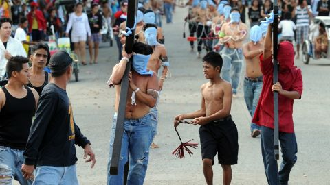 Penitents commemorate Jesus Christ's crucifixion and resurrection with self-flagellation, whipping their backs with wooden flails.