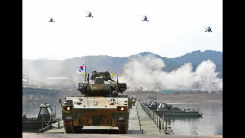 South Korean anti-aircraft armored vehicles move across a temporary bridge during a river crossing drill in Hwacheon near the North Korean border on Monday, April 1.
