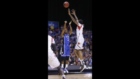 Ware tries to block Duke guard Tyler Thornton in the first half before landing awkwardly, snapping the bones in his lower leg.
