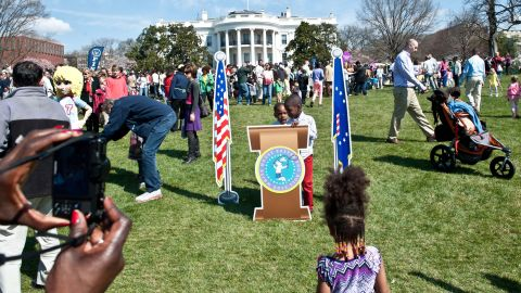 Children have their picture taken at a mock presidential podium.