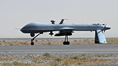 A U.S. Predator unmanned drone armed with a missile on the tarmac at Kandahar military airport in June 2010.