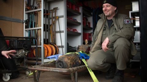 Joerg Neumann of the bomb disposal team poses next to the defused bomb.