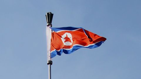PYONGYANG, NORTH KOREA - APRIL 02:  A national flag waves on Parliament roof on April 2, 2011 in Pyongyang, North Korea. Pyongyang is the capital city of North Korea and the population is about 2,500,000.  (Photo by Feng Li/Getty Images)