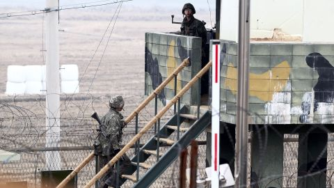 South Korean soldiers stand guard at a sentry post at the border with North Korea in the Demilitarized Zone near Imjingak, South Korea, on April 5.