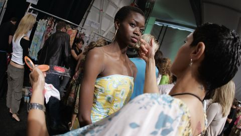 Models prepare backstage at the Spring 2005 show.