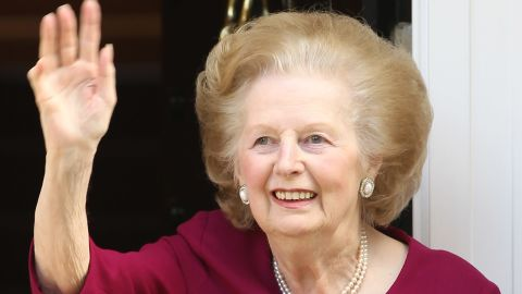 Former British Prime Minister Margaret Thatcher waves to the press at her home, after leaving Cromwell Hospital on November 1, 2010 in London, England.
