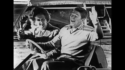 Reagan and Thatcher take a golf cart around Camp David in December 1984.