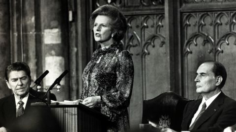 Thatcher reads a joint declaration in the Guildhall as Reagan and French President Francois Mitterand listen after a summit conference in London in May 1984.