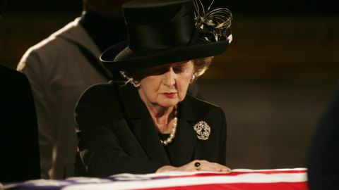 Thatcher pays her respects at Reagan's casket during his viewing at the Capitol in June 2004.