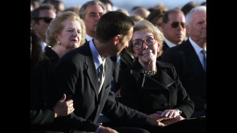 Thatcher sits behind Ronald Prescott Reagan as he comforts his mother, Nancy Reagan, during the late president's interment ceremony in Simi Valley, California, in June 2004.
